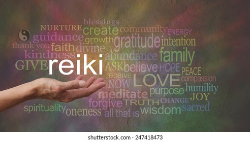 Reiki in the palm of your hand     Female hand outstretched with the word REIKI floating above, surrounded by healing related words on a wide multicolored stone effect background