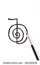"Reiki symbol ""Chokurei"" hand drawn with a brush isolated on white background."