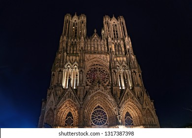 Reims Cathedral at night. This Roman Catholic cathedral was built on the site of the basilica where Clovis was baptized. This major tourist destination receives about 1 million visitors annually.