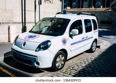 Reims France April 21, 2019 Closeup of a white police car of the penitentiary administration parked front the tribunal of Reims in the afternoon