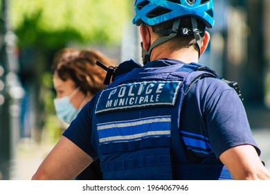 Reims France April 26, 2021 Police officer with bicycle patroling in the streets of Reims during the coronavirus outbreak hitting France