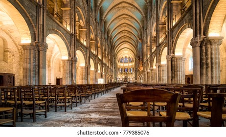 REIMS, FRANCE - AUGUST 15 2017: Warm illumination main hall interior of Saint Remi abbey in Reims, Champagne region