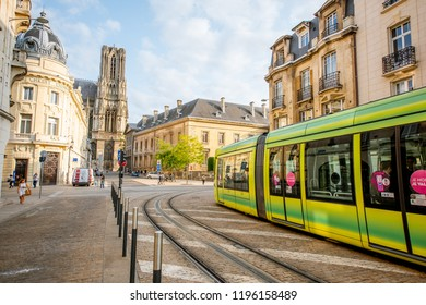 REIMS, FRANCE - August 27, 2017: Street view with tram and cathedral on the background in Reims in Champagne-Ardenne region in France