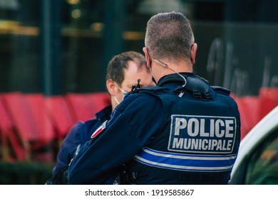 Reims France February 16, 2021 French police officer patrolling in the historical streets of Reims during coronavirus pandemic and the lockdown to impose containment of the population