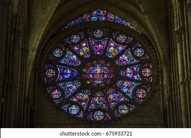 Reims, France - June 12, 2017: interior of the cathedral of Reims with south transept rose window with stained glass, France.