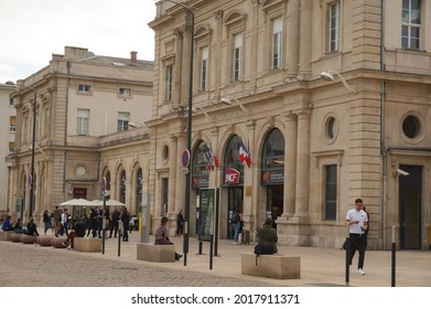 Reims, France - June 2021 - Forecourt and 19th century passenger building of Reims Centre Railway Station, a transportation infrastructure in the city center run by the State-owned train company SNCF