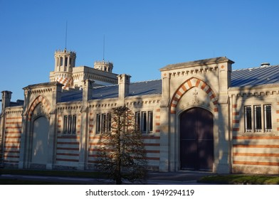 Reims, France - March 2021 - Industrial facilities, built in the 19th century in typical, English Elizabethan style, in the wine estate of the prestigious French Champagne producer Vranken-Pommery