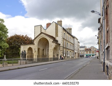 REIMS, FRANCE - MAY 13, 2017: Rue Saint-Julien with sculpture composition on the site of the former gothic church and with historical buildings