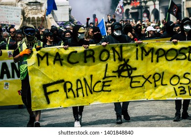 Reims France May 18, 2019 View of unknown rioters walking in the streets of Reims during the protests of the Yellow Jackets against the policy of President Macron on Saturday afternoon