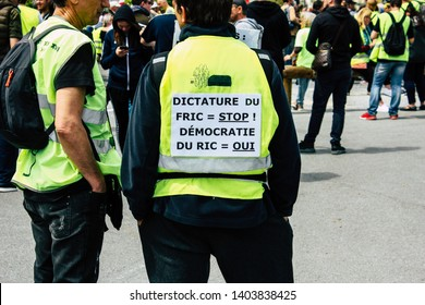 Reims France May 18, 2019 View of unknown Yellow Jackets protesters marching against the policy of President Macron on Saturday afternoon