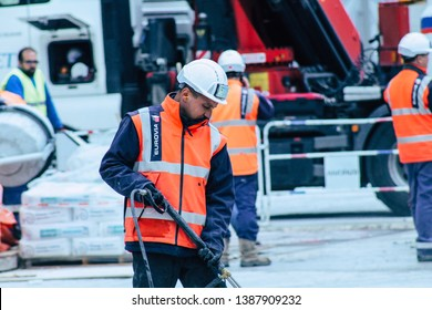 Reims France May 3, 2019 View of unknown people working on the new square of the Reims City Hall in the morning