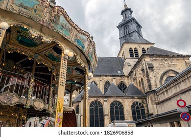 REIMS, FRANCE - OCTOBER 03, 2020. On the left a merry-go-round for children, on the right, the Saint-Jacques church.