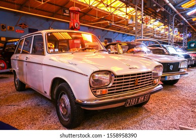 Reims, France - September 16, 2019: White estate car Peugeot 204 in the Reims-Champagne Automobile Museum.