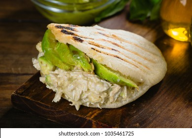 Reina pepeada, Arepa, corn bread with chicken and avocado