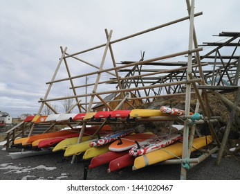 Reine, Norway, April 15, 2019: Colorful Kayak (Canoe) reserving on the wooden rack for rental.
