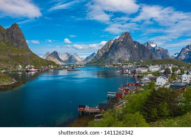 REINE, NORWAY - MAY 24, 2019; Aerial view of Reine, Lofoten islands, Norway. The fishing village of Reine. Spring time in Nordland. Blue sky. View from above.