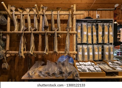 Reine, Norway - November 18, 2018: Dried cod local shop at Reine. Dried cod or stockfish is unsalted fish, especially cod, dried by cold air and wind on wooden racks at Lofoten islands, Norway