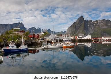 Reinefjorden, Lofoten,Norway - July 03, 2010: fishing boats in the port near the small village reine on the lofoten, norway