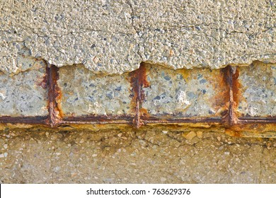 Reinforced concrete with damaged and rusty metallic reinforcement