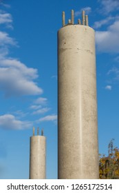 Reinforced concrete pillar around in front of blue sky