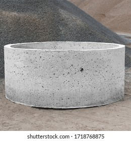 reinforced concrete products on the background of piles of gravel and rubble