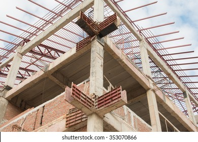 Reinforced steel bars on construction pillars, concrete details and beams at building site.