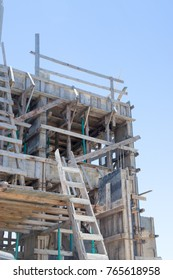 Reinforced steel bars on construction pillars, concrete details and beams at buildng site