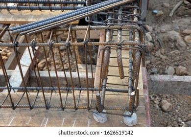 reinforcement concrete bars with wire rod used in foundation of construction site. rebar steel bars.Steel Rebars for Reinforced Concrete