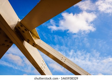 Reinforcement of the metal structure of a bridge, with white steel beams.