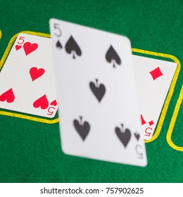 reinforcing combination card falls on the field for playing poker casino concept popular board game