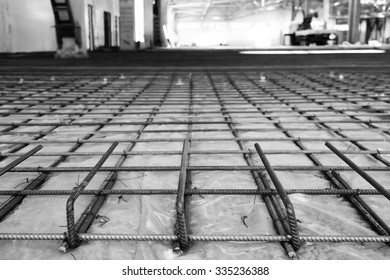 the reinforcing grid fastened with a wire from a channeled steel rod under filling of concrete floors, in black and white