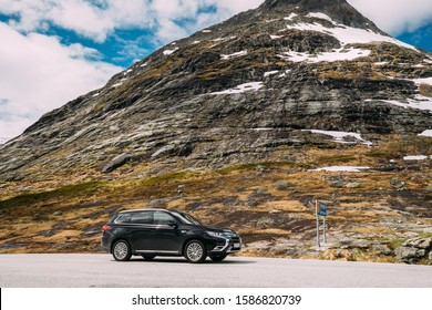 Reinheimen National Park, Norway - June 19, 2019: Black Mitsubishi Outlander PHEV on mountains road.