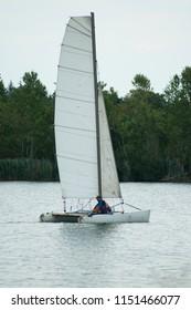 Reiningue - France - 7 August 2018 - catamaran sailing on the lake of reiningue