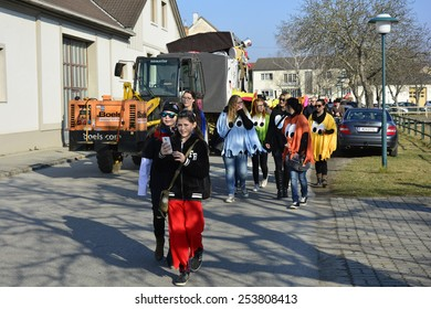 REISENBERG, AUSTRIA - FEBRUARY 14: Unidentified disguised people by traditional carnival parade in the tiny village in Lower Austria, on February 14, 2015 in Reisenberg, Austria