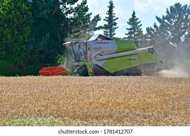 REISENBERG, AUSTRIA - JULY 10, 2020: Grain harvest on a ripe wheat field with a combine harvester in Lower Austria. on July 10, 2020 in Reisenberg, Austria