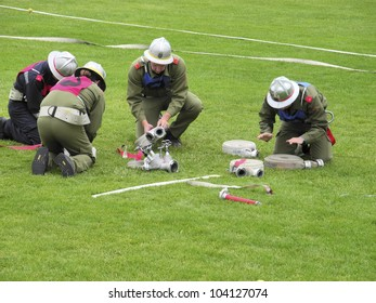 REISENBERG, AUSTRIA - JUNE 02: Members of different volunteer fire brigades participate in a yearly all volunteer competition on a sports ground in Lower Austria on June 02, 2012 in Reisenberg, Austria