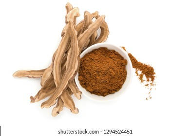 Reishi mushroom powder in bowl isolated on white background from above. Superfood and detox concept.