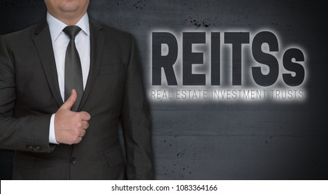 Reits concept and businessman with thumbs up.