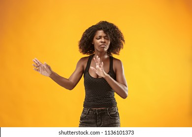 Reject, rejection, doubt concept. Doubtful afro woman with thoughtful expression making choice. Young emotional woman. Human emotions, facial expression concept. Front . Studio. Isolated on trendy