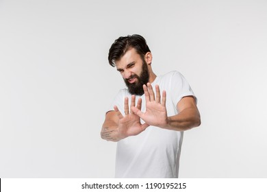 Reject, rejection, doubt concept. Doubtful man with thoughtful expression making choice. Young emotional man. Human emotions, facial expression concept. Front . Studio. Isolated on white