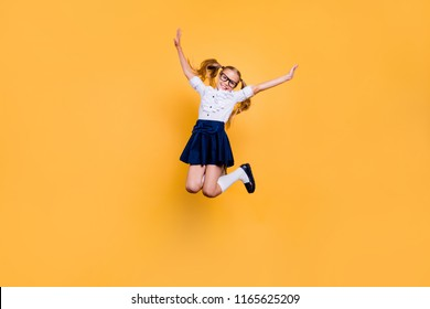 Rejoice delight enthusiasm positive laugh people person concept. Full length size studio photo of cheerful excited sweet cute clever optimistic jumping schoolchild gesturing hands isolated background