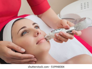 Rejuvenating facial treatment. Model getting lifting therapy massage in a beauty SPA salon. Exfoliation, Rejuvenation And Hydratation. Model and Doctor. Cosmetology.