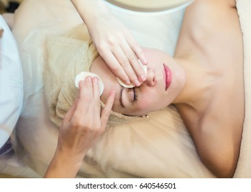 Rejuvenating facial treatment. Model getting lifting therapy massage in a beauty SPA salon. Woman receiving spa treatment.