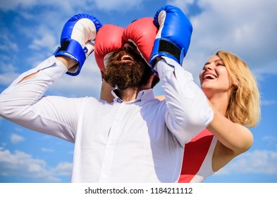Relations game or struggle. Play and have fun. Tricks every woman needs to know. Girl smiling face covers male face boxing gloves. Break rules success. Dexterous tricks play relations. Tricky female.