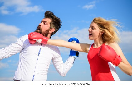 Relations as struggle concept. Man and woman fight boxing gloves blue sky background. Defend your opinion in confrontation. Relations and family life as everyday struggle. Couple in love fighting.