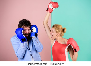 Relations as struggle concept. Strength and power. knockout punching. who is right. win the fight. bearded man hipster fighting with woman. family couple boxing glove. problems in relationship. sport.