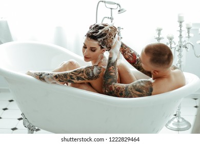 Relationship. Beautiful couple is bathing together