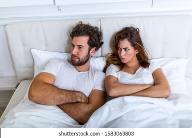 Relationship concept. Top view of young couple lying on the bed. Couple having a fight in the bed. concept about relationship and problems between couples. Sexual frustration. Lovers ignore each other