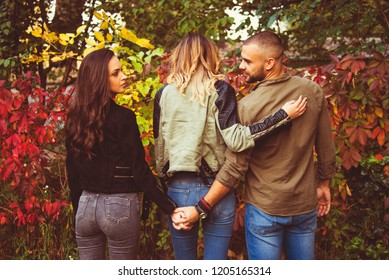 relationship concept tree people arguing  outdoor in park problems, secret behind back