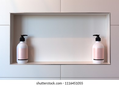 Relationship concept - two shampoo dispencers facing each other with copy space between them